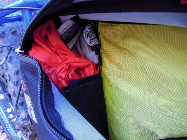 The back compartment stuffed with: spare tube, patch repair kit & other repair supplies, emergency ditty bag, and a lightweight wind jacket.