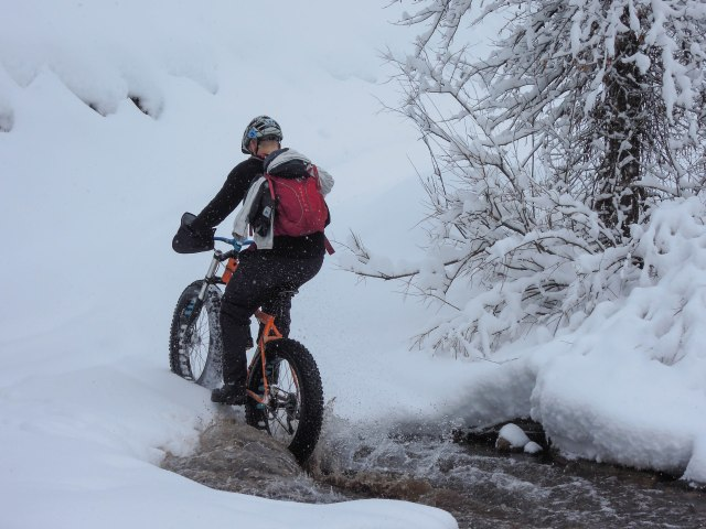Alex showing how to cross a cold creek, on his 9:Zero:7 with Bud and Lou tires.