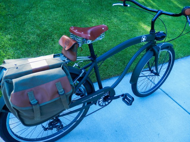 Canvas and leather saddlebags modified to fit the rack. And a custom seat bag.